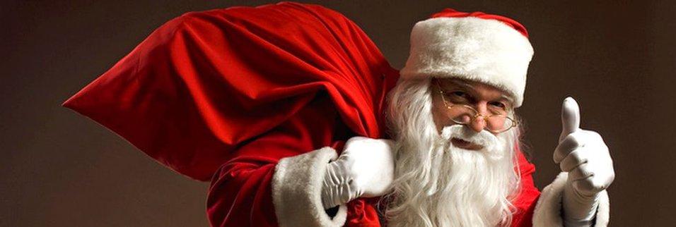Zdjęcie [url=http://www.shutterstock.com/pl/pic-156220142/stock-photo-photo-of-happy-santa-claus-outdoors-in-snowfall-carrying-gifts-to-children.html?src=y1FoqDONTaH2JOalYE0siA-1-26]mikołaja[/url] pochodzi z serwisu shutterstock.com